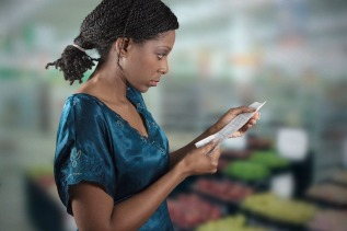 black-woman-looking-at-grocery-shopping-list-1